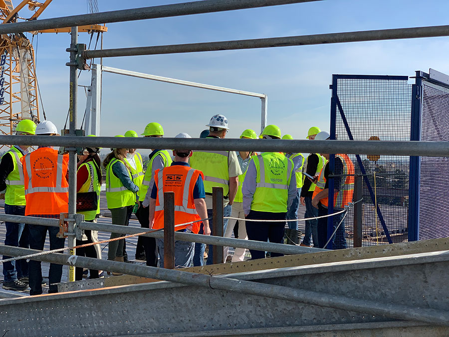 BDG Topping off - group gathering for the placement of steel beam